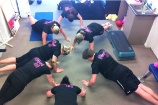 A picture of the 100 Day Challenge entrants doing press ups